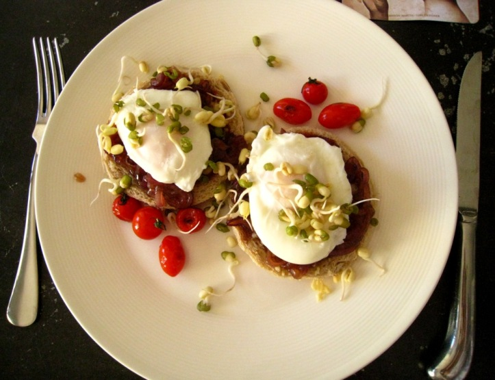 oached eggs with mung bean sprouts, atop caramelised red onions on fried toast rounds