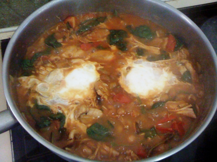 eggs poached in home-made baked beans